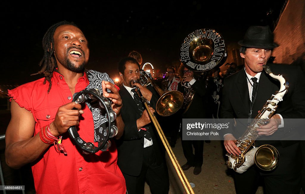Musicians of Preservation Hall Jazz band perform with Arcade Fire in the crowd during day 3 of the 2014 Coachella Valley Music & Arts Festival at the Empire Polo Club on April 20, 2014 in Indio, California.