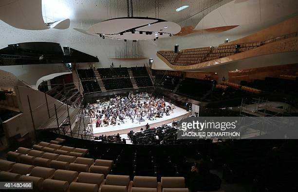 Musicians of the Chamber Orchestra of Paris perform during a rehearsal at the new Philharmonie de Paris on January 13 2015 The Philharmonie de Paris...
