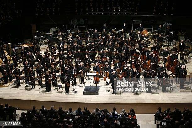 Musicians of the Orchestre de Paris acknowledge the crowd during the gala opening of the Paris Philharmonie concert hall on January 14 2015 in Paris...