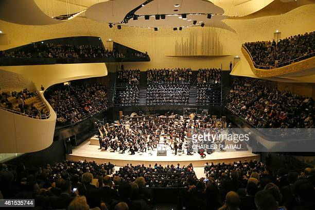 Musicians of the Orchestre de Paris perform during the gala opening of the Paris Philharmonie concert hall on January 14 2015 in Paris The...