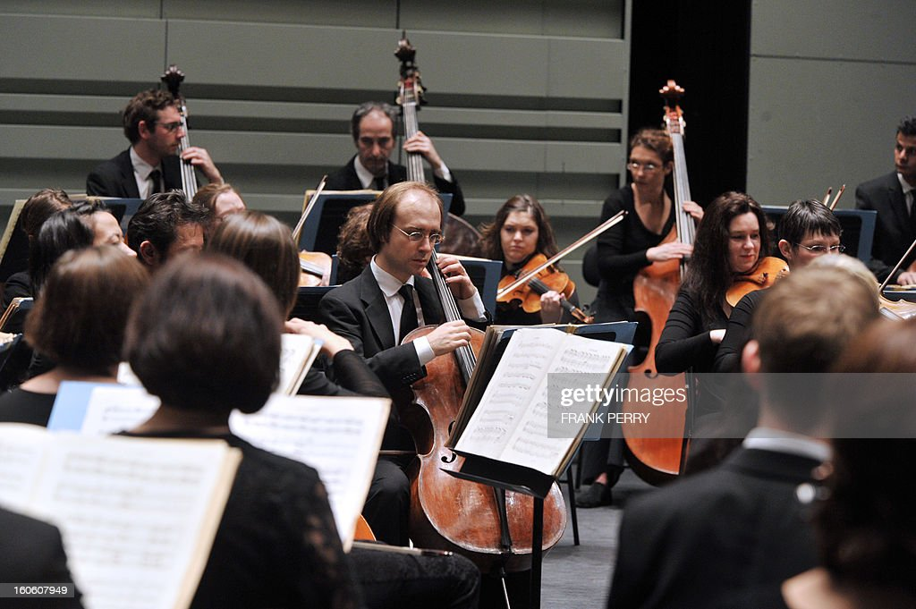 Musicians of the 'Orchestre Lamoureux,' conducted by French Fayçal Karoui, perform Maurice Ravel's Bolero on February 3, 2013, as part of the 'Folle Journee' music festival at the Cite des Congres in Nantes.