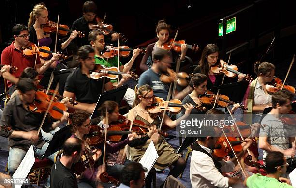 Musicians of The WestEastern Divan youth orchestra conducted by Daniel Barenboim rehearse in the Royal Albert Hall ahead of their performance in the...