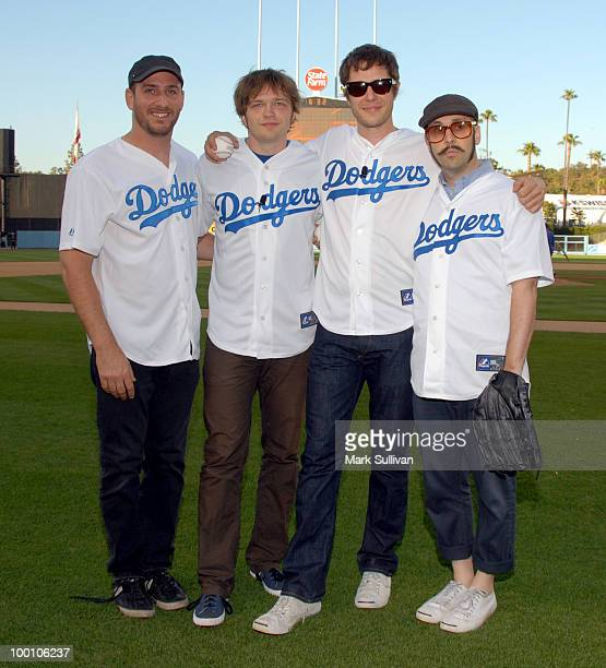 Musicians OK Go Dan Konopka Andy Ross Damian Kulash and Tim Nordwind pose before throwing the ceremonial first pitch prior to the game between the...