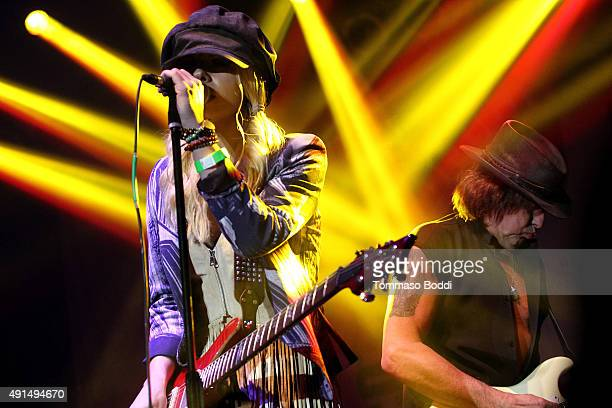 Musicians Orianthi and Richie Sambora perform on stage during the Medlock Krieger Celebrity Golf Invitational 2015 All Star Concert held at Moorpark...