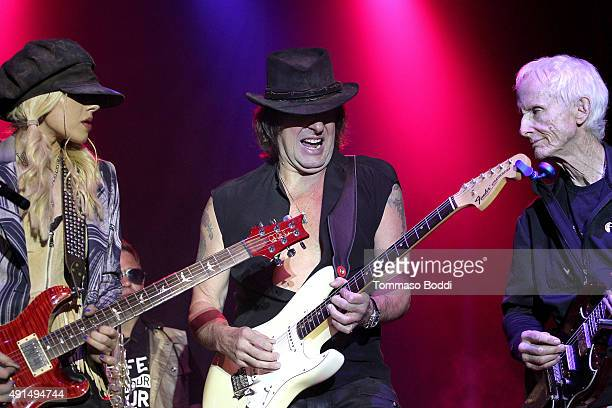 Musicians Orianthi Richie Sambora and Robby Krieger perform on stage during the Medlock Krieger Celebrity Golf Invitational 2015 All Star Concert...