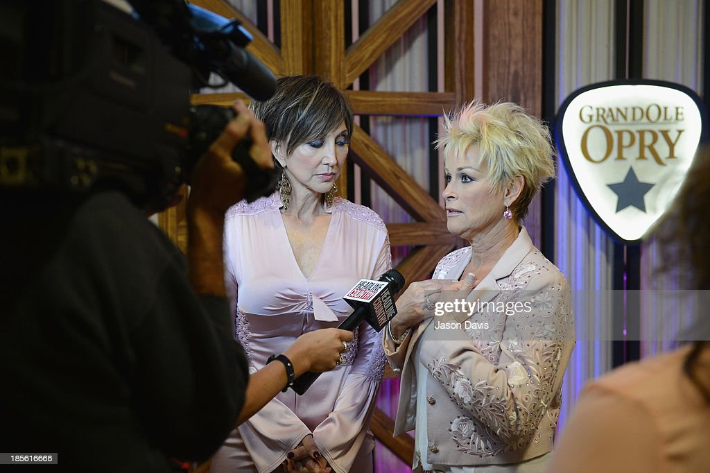 Musicians Pam Tillis and Lorrie Morgan appear during the 5th annual Opry Goes Pink show at The Grand Ole Opry on October 22, 2013 in Nashville, Tennessee.