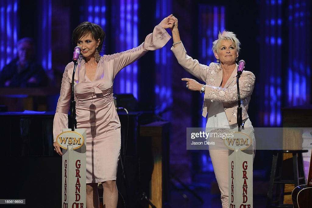 Musicians Pam Tillis and <a gi-track='captionPersonalityLinkClicked' href=/galleries/search?phrase=Lorrie+Morgan&family=editorial&specificpeople=1063734 ng-click='$event.stopPropagation()'>Lorrie Morgan</a> perform during the 5th annual Opry Goes Pink show at The Grand Ole Opry on October 22, 2013 in Nashville, Tennessee.
