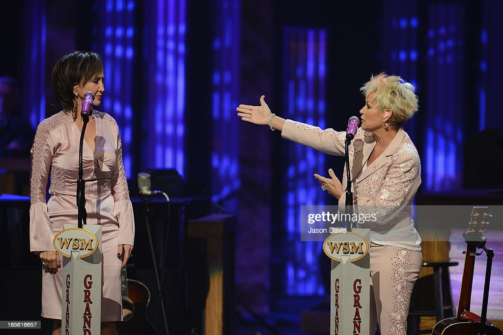 Musicians Pam Tillis and Lorrie Morgan perform during the 5th annual Opry Goes Pink show at The Grand Ole Opry on October 22, 2013 in Nashville, Tennessee.