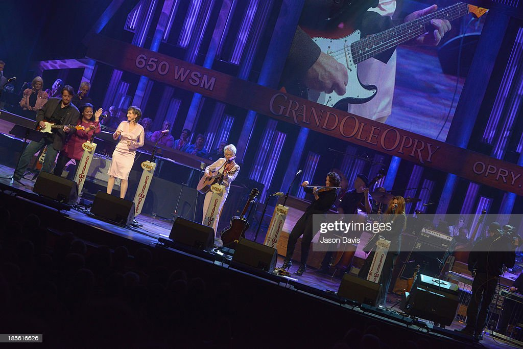 Musicians Pam Tillis and Lorrie Morgna perform during the 5th annual Opry Goes Pink show at The Grand Ole Opry on October 22, 2013 in Nashville, Tennessee.
