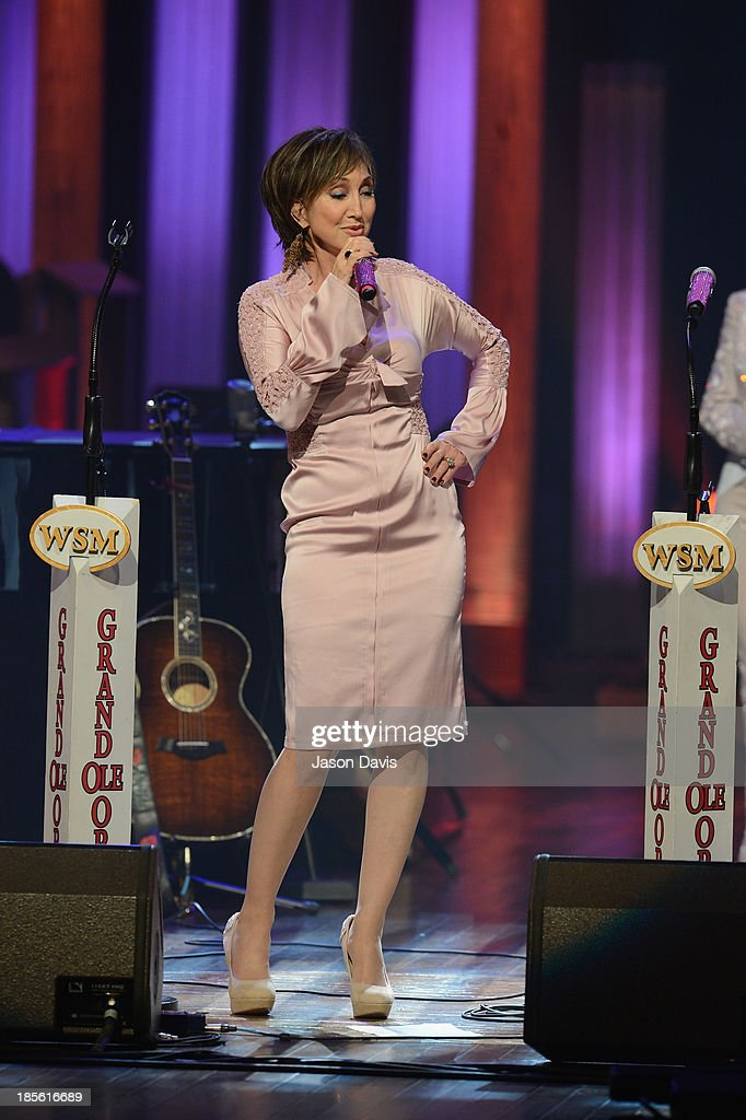 Musicians Pam Tillis performs during the 5th annual Opry Goes Pink show at The Grand Ole Opry on October 22, 2013 in Nashville, Tennessee.