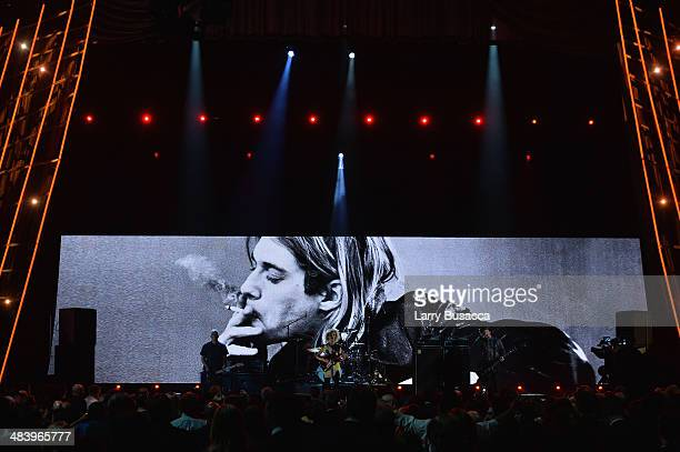 Musicians Pat Smear St Vincent and Krist Novoselic of Nirvana perform onstage at the 29th Annual Rock And Roll Hall Of Fame Induction Ceremony at...