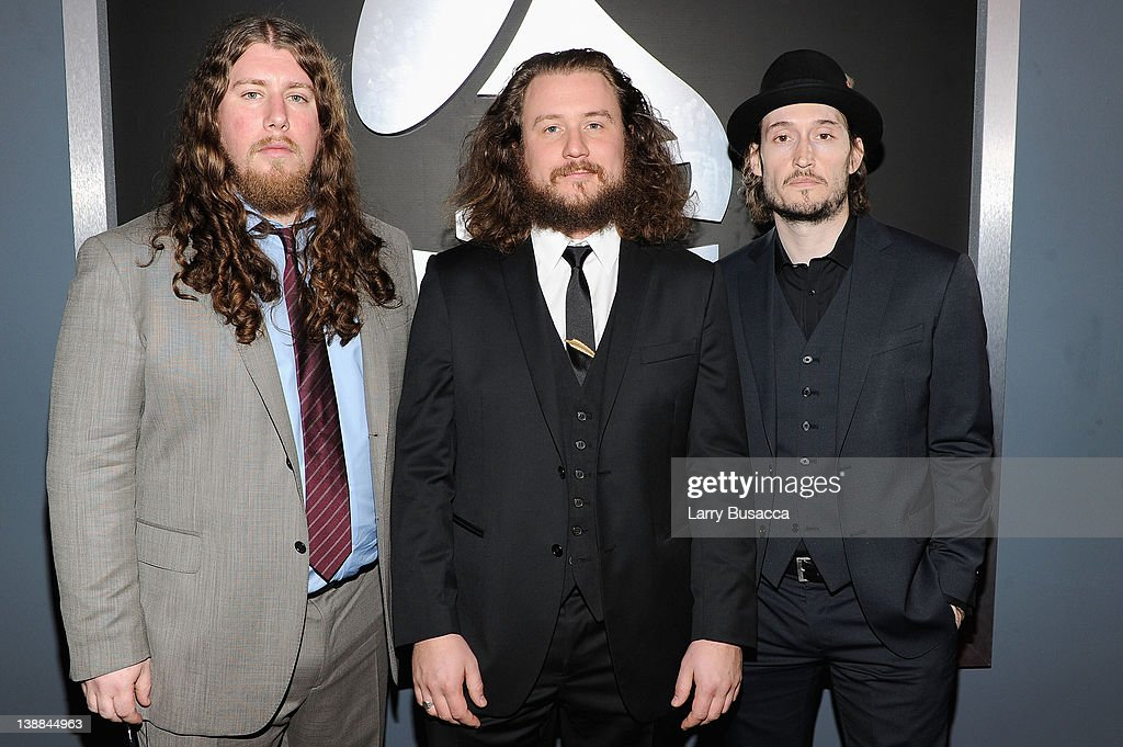 Musicians Patrick Hallahan, <a gi-track='captionPersonalityLinkClicked' href=/galleries/search?phrase=Jim+James&family=editorial&specificpeople=563700 ng-click='$event.stopPropagation()'>Jim James</a> and Carl Broemel of the band My Morning Jacket arrives at the 54th Annual GRAMMY Awards held at Staples Center on February 12, 2012 in Los Angeles, California.