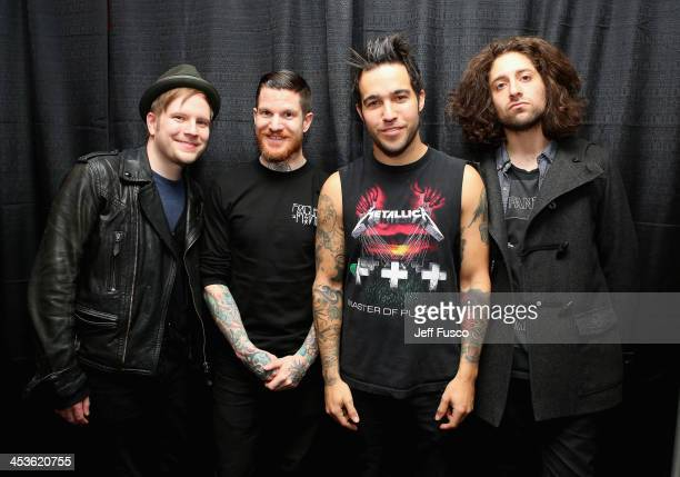 Musicians Patrick Stump Andy Hurley Pete Wentz and Joe Trohman of Fall Out Boy attend Q102's Jingle Ball 2013 presented by Bernie Robbins Jewelers at...
