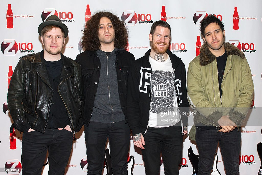 Musicians Patrick Stump, Joe Trohman, Andy Hurley, and Pete Wentz of Fall Out Boy attend the Z100 & Coca-Cola All Access Lounge at Hammerstein Ballroom on December 13, 2013 in New York City.