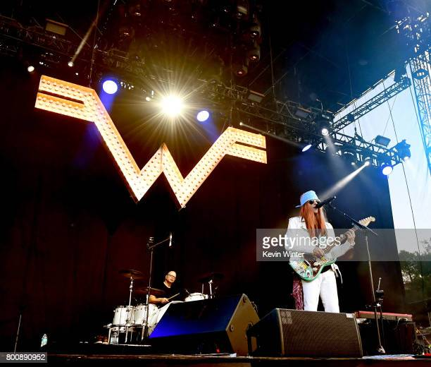 Musicians Patrick Wilson and Rivers Cuomo of musical group Weezer perform on The Oak stage during Arroyo Seco Weekend at the Brookside Golf Course at...