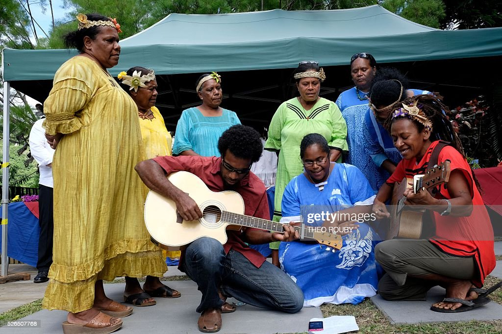 Musicians perform during a welcoming ceremony for the French prime minister on April 30, 2016 in Hienghene, as part of his visit to the French Pacific territory of New Caledonia. / AFP / Th��o Rouby