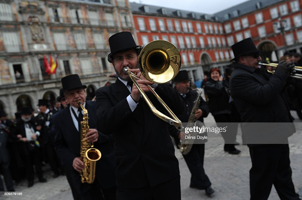 Musicians perform during the ''Burial of the Sardine'' dance in Mayor square on February 10, 2016 in Madrid, Spain. The Sardine procession is a centuries-old Spanish tradition made famous by a painting by Spanish artist Francisco de Goya called 'El Entierro de La Sardina'. The mourners hold a mock funeral procession mourning the end of Carnival through the heart of old 'Castizo' Madrid visiting and enjoying the wines and tapas of local taverns.