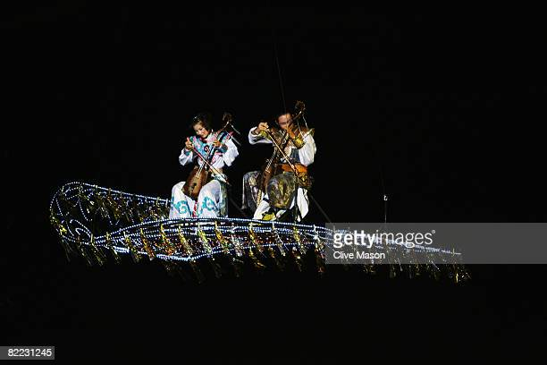 Musicians perform during the opening launch ceremony held at the Qingdao Olympic Sailing Center during day 1 of the Beijing 2008 Olympic Games on...