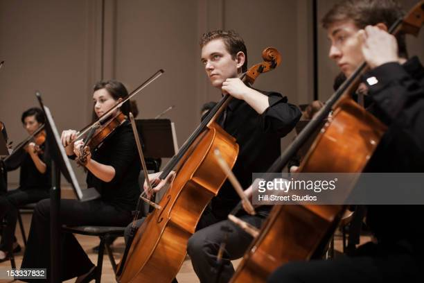 Musicians performing in orchestra