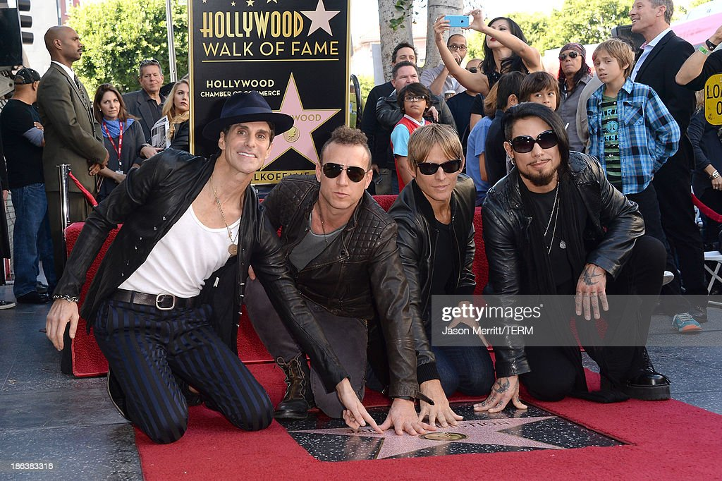 Musicians Perry Farrell, Stephen Perkins, Chris Chaney and Dave Navarro attend the ceremony honoring them with a Star on The Hollywood Walk of Fame on October 30, 2013 in Hollywood, California.