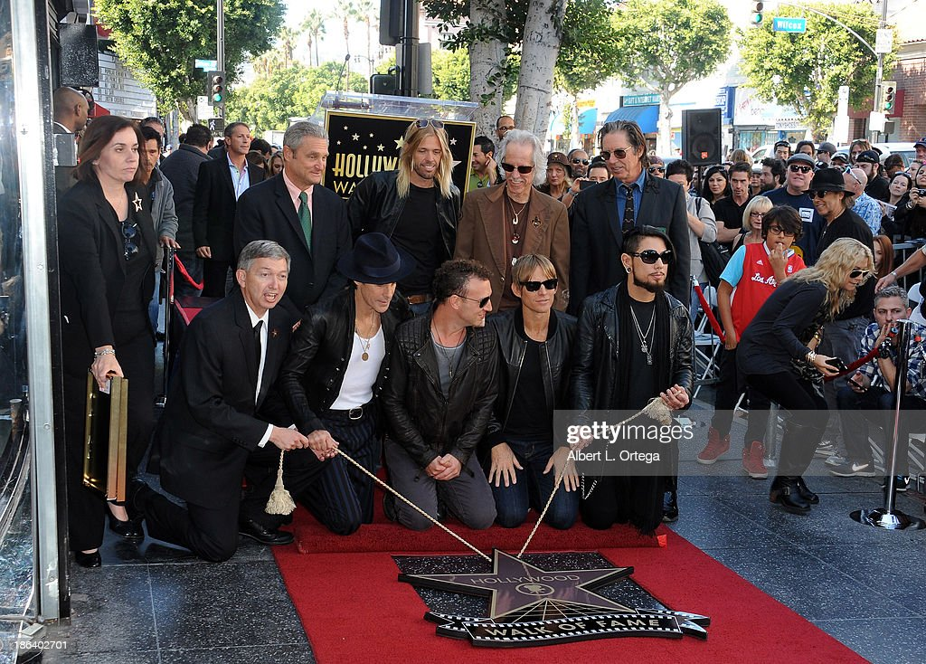 Musicians Perry Farrell, Taylor Hawkins, John Densmore, Stephen Perkins, John Doe, Chris Chaney and Dave Navarro Jane's Addiction Honored On The Hollywood Walk Of Fame on October 30, 2013 in Hollywood, California.