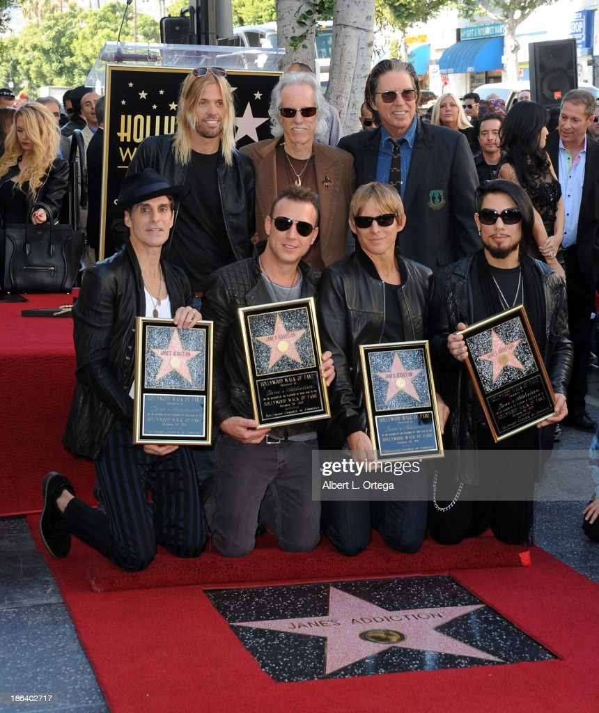 Musicians <a gi-track='captionPersonalityLinkClicked' href=/galleries/search?phrase=Perry+Farrell&family=editorial&specificpeople=213012 ng-click='$event.stopPropagation()'>Perry Farrell</a>, <a gi-track='captionPersonalityLinkClicked' href=/galleries/search?phrase=Taylor+Hawkins&family=editorial&specificpeople=220594 ng-click='$event.stopPropagation()'>Taylor Hawkins</a>, <a gi-track='captionPersonalityLinkClicked' href=/galleries/search?phrase=John+Densmore&family=editorial&specificpeople=926933 ng-click='$event.stopPropagation()'>John Densmore</a>, Stephen Perkins, John Doe, <a gi-track='captionPersonalityLinkClicked' href=/galleries/search?phrase=Chris+Chaney&family=editorial&specificpeople=614601 ng-click='$event.stopPropagation()'>Chris Chaney</a> and <a gi-track='captionPersonalityLinkClicked' href=/galleries/search?phrase=Dave+Navarro&family=editorial&specificpeople=202159 ng-click='$event.stopPropagation()'>Dave Navarro</a> Jane's Addiction Honored On The Hollywood Walk Of Fame on October 30, 2013 in Hollywood, California.