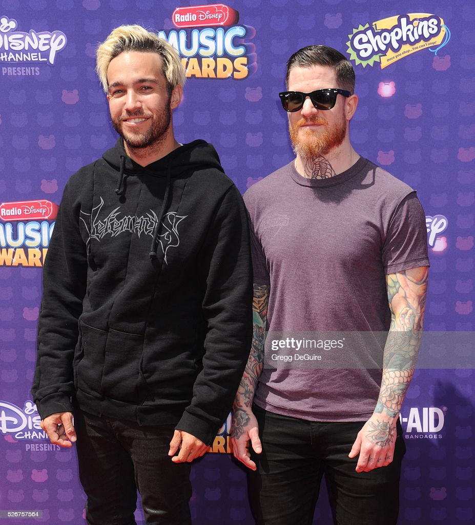 Musicians Pete Wentz and Andy Hurley arrive at the 2016 Radio Disney Music Awards at Microsoft Theater on April 30, 2016 in Los Angeles, California.