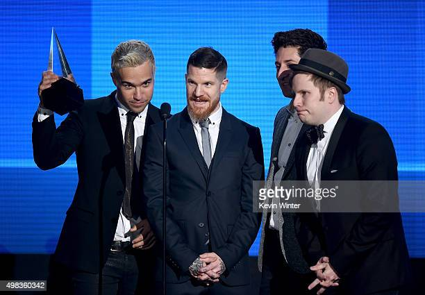 Musicians Pete Wentz Andy Hurley Joe Trohman and Patrick Stump of Fall Out Boy accept the Favorite Alternative Artist award onstage during the 2015...