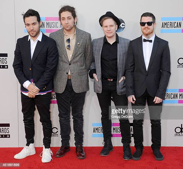 Musicians Pete Wentz Joe Trohman Patrick Stump and Andy Hurley of Fall Out Boy arrive at the 2013 American Music Awards at Nokia Theatre LA Live on...