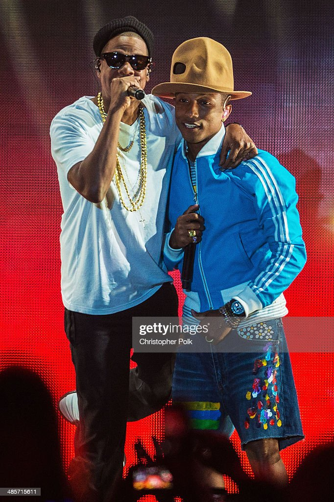 Musicians <a gi-track='captionPersonalityLinkClicked' href=/galleries/search?phrase=Pharrell+Williams&family=editorial&specificpeople=161396 ng-click='$event.stopPropagation()'>Pharrell Williams</a> (R) and Jay Z perform onstage during day 2 of the 2014 Coachella Valley Music & Arts Festival at the Empire Polo Club on April 19, 2014 in Indio, California.