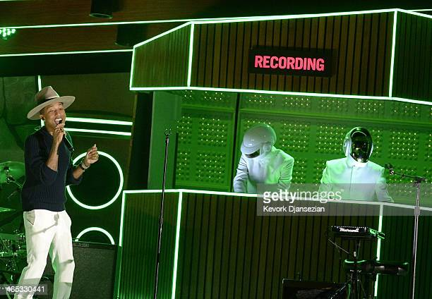 Musicians Pharrell Williams with Thomas Bangalter and GuyManuel de HomemChristo of Daft Punk perform onstage during the 56th GRAMMY Awards at Staples...