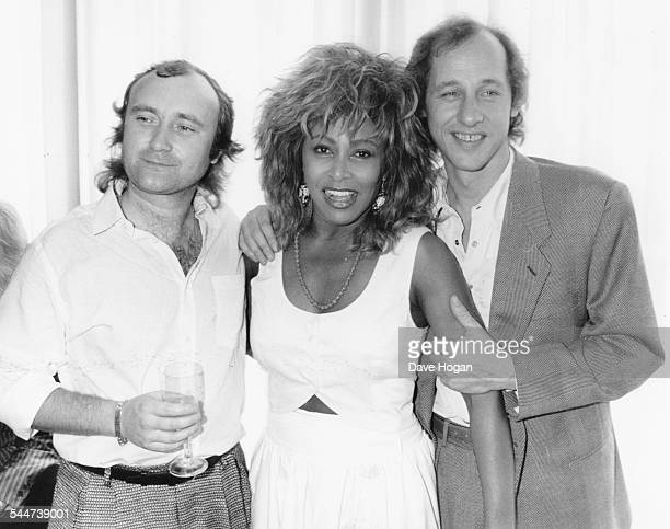 Musicians Phil Collins Tina Turner and Mark Knopfler at an event to honor Princess Michael of Kent England July 8th 1986