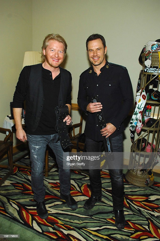 Musicians Phillip Sweet (L) and Jimi Westbrook of Little Big Town attend the Backstage Creations Celebrity Retreat at the Mandalay Bay Events Center on December 10, 2012 in Las Vegas, Nevada.