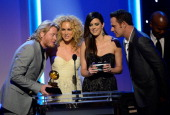 Musicians Phillip Sweet Kimberly Schlapman Karen Fairchild and Jimi Westbrook of the group Little Big Town winners of Best Country Duo/Group...