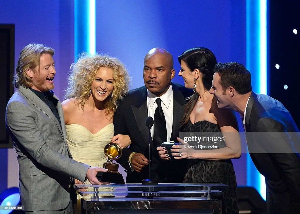 Musicians Phillip Sweet, Kimberly Schlapman, Karen Fairchild, and Jimi Westbrook of the group Little Big Town, winners of Best Country Duo/Group Performance, with host David alan Grier (center) onstage at the The 55th Annual GRAMMY Awards at Nokia Theatre on February 10, 2013 in Los Angeles, California.