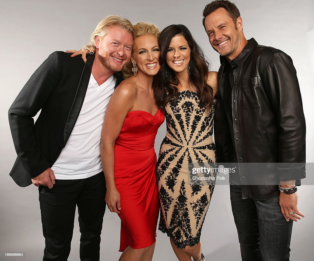 Musicians Phillip Sweet, Kimberly Schlapman, Karen Fairchild and Jimi Westbrook of Little Big Town pose at the Wonderwall portrait studio during the 2013 CMT Music Awards at Bridgestone Arena on June 5, 2013 in Nashville, Tennessee.