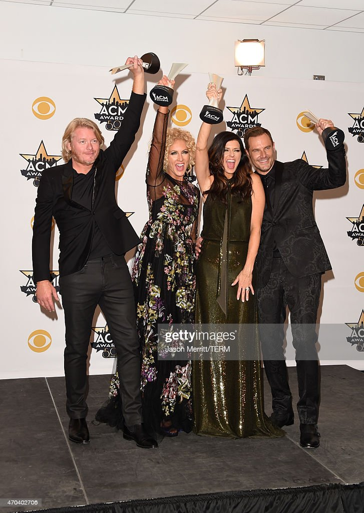 Musicians Phillip Sweet Kimberly Schlapman Karen Fairchild and Jimi Westbrook of Little Big Town winners of the Vocal Group of the Year pose in the...