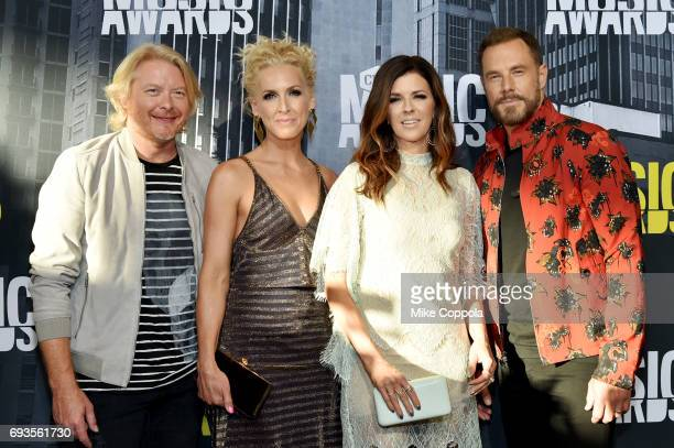 Musicians Phillip Sweet Kimberly Schlapman Karen Fairchild and Jimi Westbrook of Little Big Town attends the 2017 CMT Music Awards at the Music City...