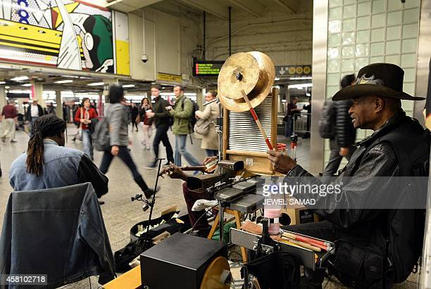 Musicians play at a subway station in New York on October 30 2104 The US economy grew at a strongerthanexpected pace in the third quarter lifted by...