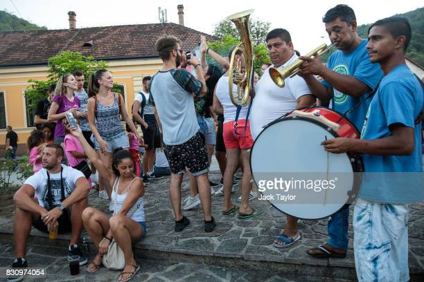 Musicians play for revellers in the town centre during the Guca Trumpet Festival on August 10 2017 in Guca Serbia Thousands of revellers attend the...