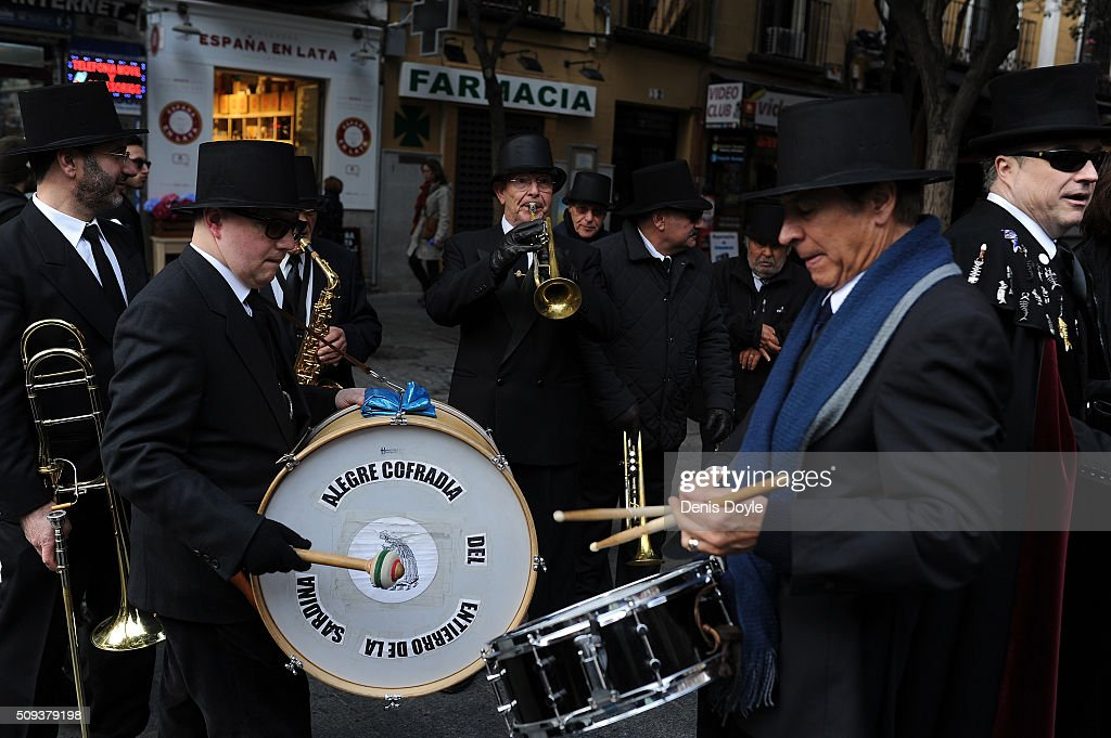 Musicians play funeral music during the Burial of the Sardine procession on February 10, 2016 in Madrid, Spain. The Sardine procession is a centuries-old Spanish tradition made famous by a painting by Spanish artist Francisco de Goya called 'El Entierro de La Sardina'. The mourners hold a mock funeral procession mourning the end of Carnival through the heart of old 'Castizo' Madrid visiting and enjoying the wines and tapas of local taverns.