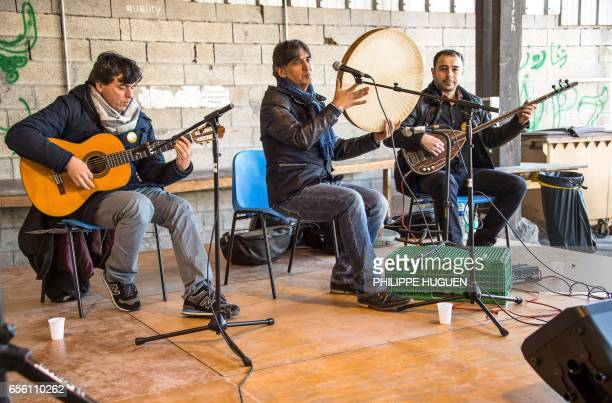 Musicians play in La Liniere camp in GrandeSynthe northern France on March 21 during the celebrations of Nauroz 'New day' the first day of spring and...