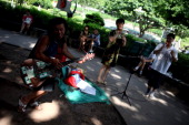 Musicians play instruments and sing in a park on August 4 2013 in Chongqing China Chongqing is a major city in southwest China and became the...