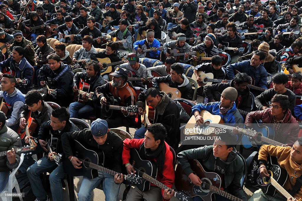 Musicians play John Lennon's 'Imagine' in a memorial tribute to the 23-year old Indian gang rape victim, during a mass guitar ensemble played by some 600 guitarists in Darjeeling on January 3, 2013. Protesters have massed in Indian cities daily since the December 16 assault demanding the government and police take sex crime more seriously, with tougher penalties for offenders and even chemical castration being considered. Five men accused of gang-raping a 23-year-old student on a moving bus in New Delhi in a deadly crime that repulsed the nation are to be formally charged in court January 3. AFP PHOTO/Diptendu DUTTA