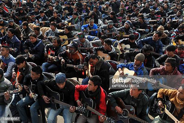 Musicians play John Lennon's 'Imagine' in a memorial tribute to the 23year old Indian gang rape victim during a mass guitar ensemble played by some...