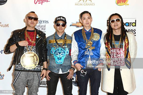 Musicians Prohgress DJ Virman Kev Nish and JSplif of Far East Movement pose in the press room at the 2012 Billboard Music Awards held at the MGM...