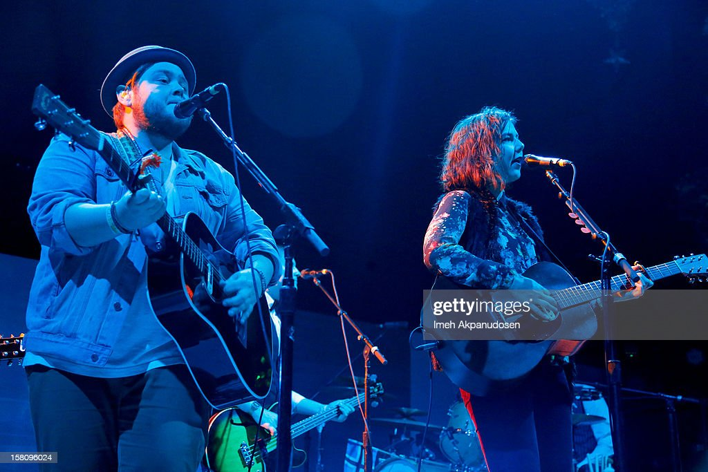 Musicians Ragnar Thorhallsson (L) and Nanna Bryndis Hilmarsdottir of the band Of Monsters and Men perform onstage at the 23rd Annual KROQ Almost Acoustic Christmas at Gibson Amphitheatre on December 9, 2012 in Universal City, California.