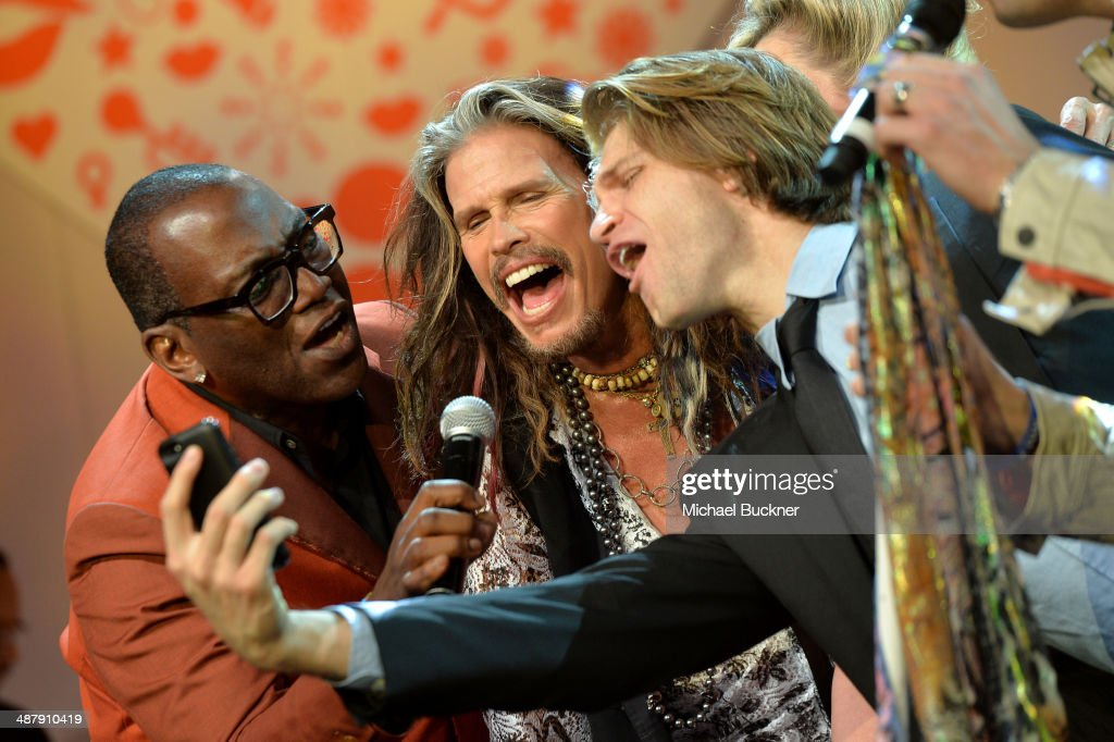 Musicians Randy Jackson and Steven Tyler with Actor Keegan Allen onstage at the 21st annual Race to Erase MS at the Hyatt Regency Century Plaza on May 2, 2014 in Century City, California.