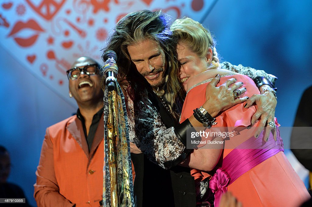 Musicians Randy Jackson and Steven Tyler with Nancy Davis onstage at the 21st annual Race to Erase MS at the Hyatt Regency Century Plaza on May 2, 2014 in Century City, California.