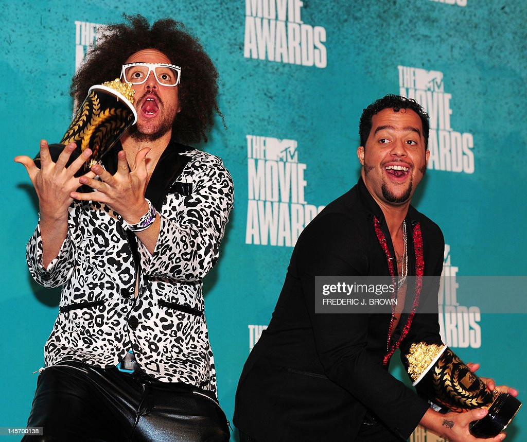 Musicians Red Foo and SkyBlu (R) of LMFAO poses in the press room with their award for 'Best Music' for 'Party Rock Anthem,' at the MTV Movie Awards at Universal Studios, in Los Angeles, California, on June 3, 2012.